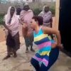 Woman dances to beggars song