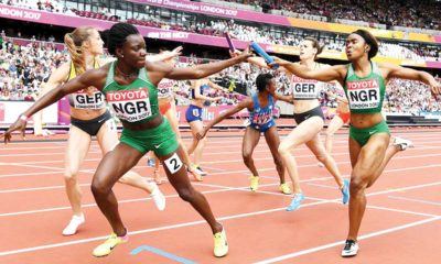 Nigeria's Glory Onome Nathaniel (right) hands the baton over to Nigeria's Emerald Egwim (second left) as Germany's Nadine Gonska (second right) hands off to Germany's Svea Kohrbruck (left) in the heats of the women's 4x400m relay athletics event at the 2017 IAAF World Championships in London. Kirill KUDRYAVTSEV