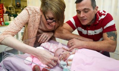 Surgery: Three-week-old Vanellope Hope Wilkins, who was due to be delivered on Christmas Eve before an incredibly rare condition, in which the heart grows on the outside of the body, meant she had to be born prematurely by caesarean section on November 22, is caressed and touched by her parents Naomi Findlay and Dean Wilkins, at Glenfield Hospital in Leicester, after surviving, in what is believed to be a UK first. (Photo by Ben Birchall/PA Images via Getty Images)