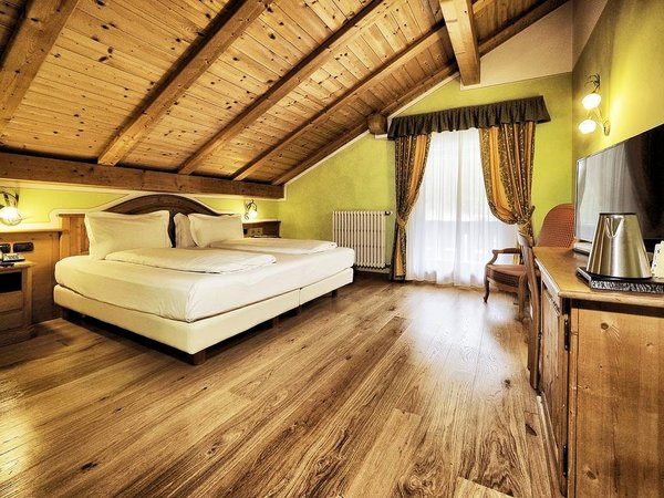 slaapkamer-hotel-bertelli-madonna-di-campiglio-skirama-dolomiti-wintersport-interlodge