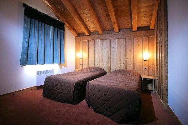 residence-alba-interieur-slaapkamer-les-deux-alpes-wintersport-frankrijk-ski-snowboard-raquettes-schneeschuhlaufen-langlaufen-wandelen-interlodge.jpg