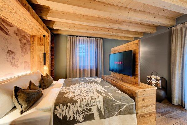 slaapkamer-ravelli-lodge-mezzana-skirama-dolomiti-wintersport-italie-interlodge.jpg
