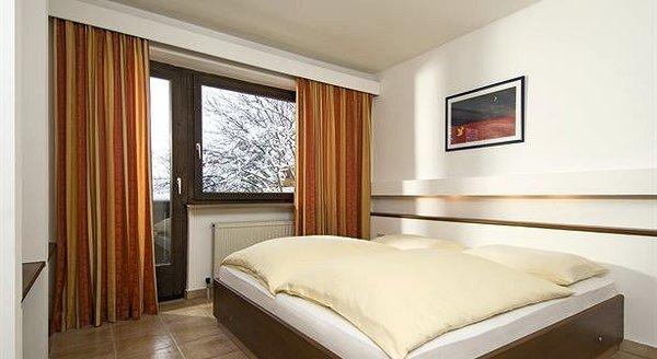 slaapkamer-apartments-london-pub-kirchberg-wintersport-oostenrijk.jpg