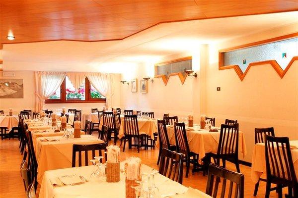 restaurant-hotel-alpina-madonna-di-campiglio-skirama-dolomiti-wintersport-italie-ski-snowboard-raquettes-langlaufen-wandelen-interdloge.jpg