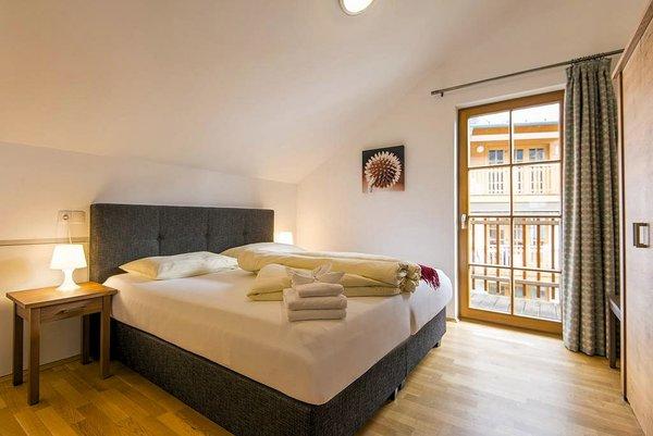 slaapkamer-schonblick-mountain-resort-rauris-wintersport-oostenrijk-interlodge