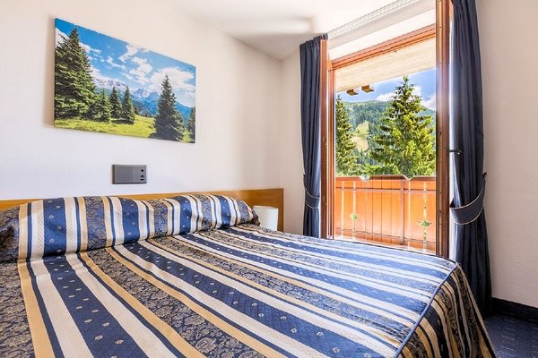 kamer-dolomiti-hotel-alpina-madonna-di-campiglio-skirama-dolomiti-wintersport-italie-interlodge