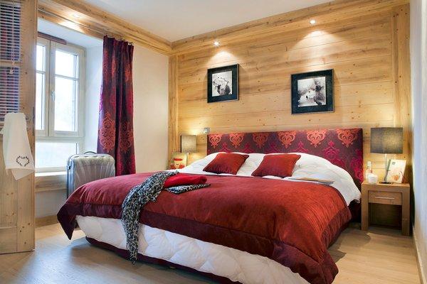 residence-les-chalets-d-angele-slaapkamer-rood-chatel-les-portes-du-soleil-interlodge.jpg