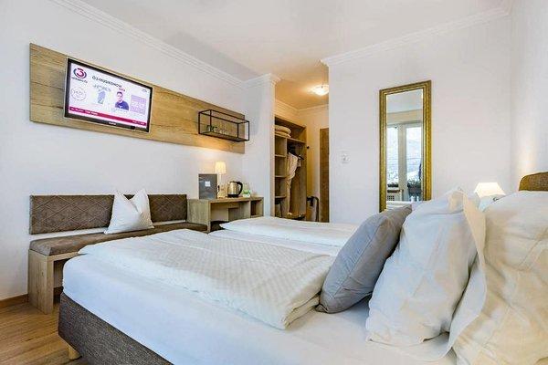 slaapkamer-hotel-seehof-zell-am-see-europa-sportregion-wintersport-oostenrijk-interlodge