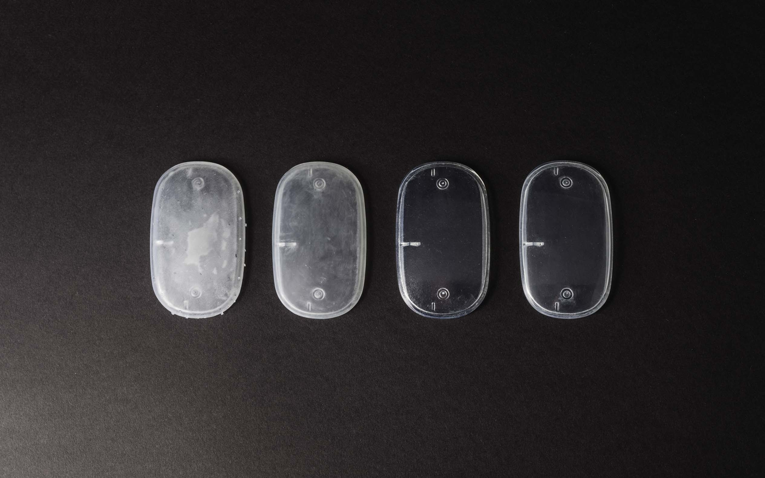 An electronic enclosure 3D printed with SLA in Clear resin during different post-processing steps
