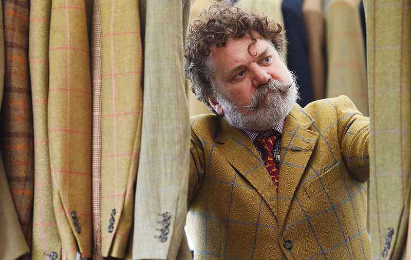 Shopping for tweed. A country gent eyes up the tweed at the Game Fair.