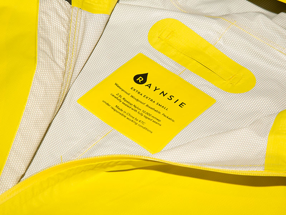 RAYNSIE | Dip Yellow Red | Ripstop nylon | Waterproof onesie for urban cycling, outdoor, festival and camping