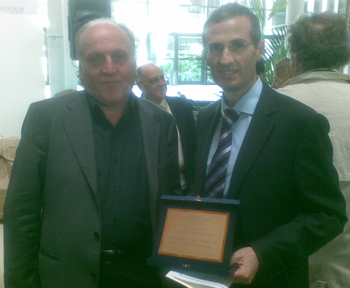 Ing. Avanzi of Aprica receives the prize from President Edo Ronchi