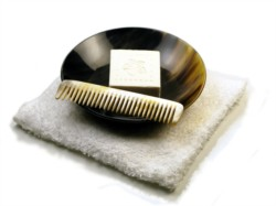 A range of natural horn handmade accessories for use in the bathroom.