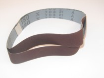 Abrasive belts 25mm to 49mm wide.