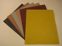 Abrasive sanding sheets for hand sanding and finishing, and orbital sanders