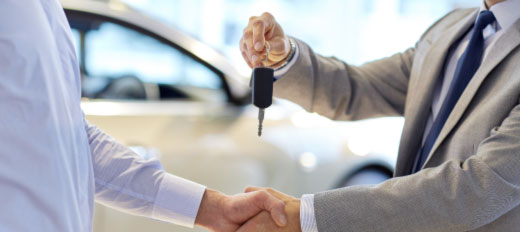 Handing over keys to a new car bought with Admiral CarFinance