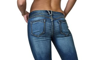 lady in jeans showing lost weight