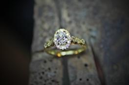 18ct Gold Oval Diamond with a Diamond  set Halo & shoulders