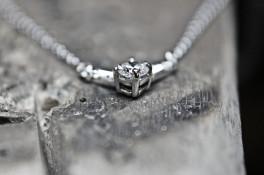 Platinum round diamond & tapered baguette pendant