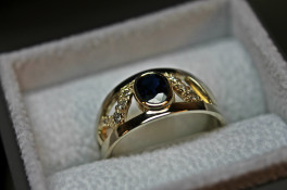 multi colour gold ring using oval sapphire & diamonds