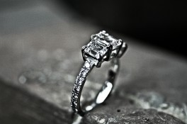 EMERALD CUT THREE STONE DIAMOND RING IN PALLADIUM