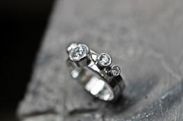 Unusual rub over diamond setting