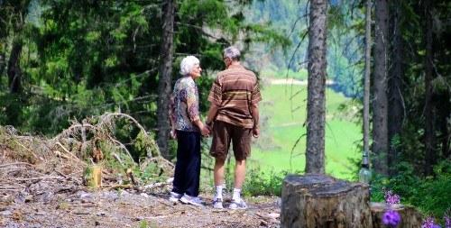 Older people holding hands