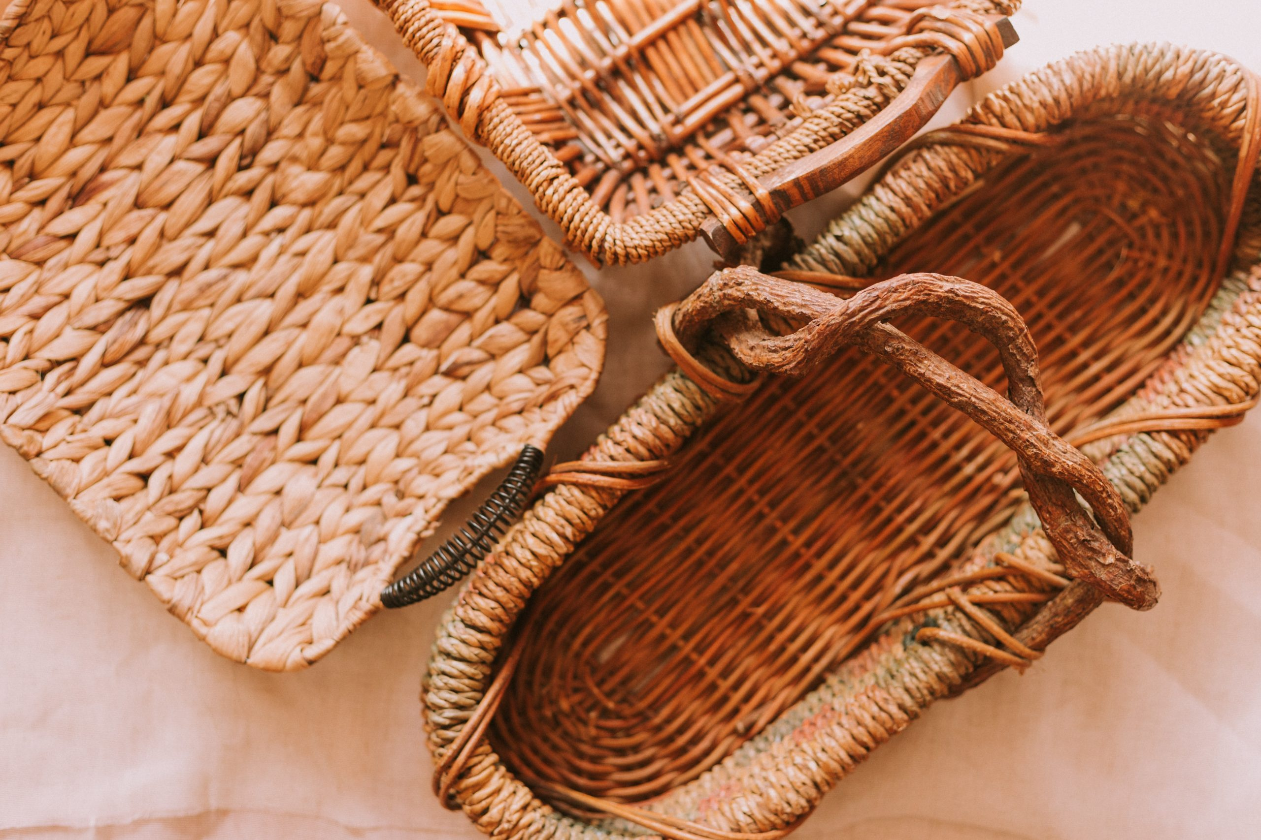 three woven baskets against brown background