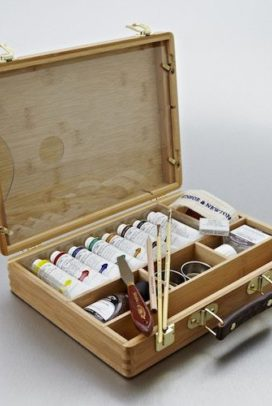 Painting Pink Poodles and Other Creatures with acrylic paint set that arrived confidently in a wooden briefcase