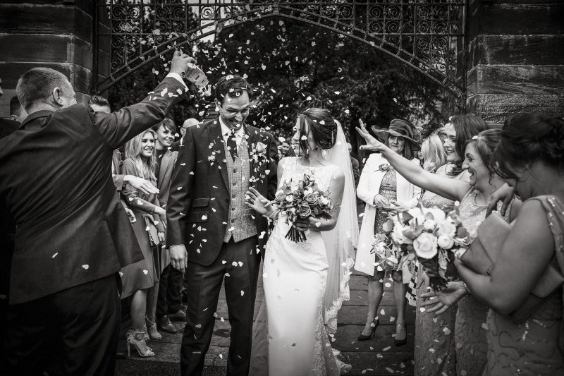 Confetti being thrown at the bride and groom Hawarden Church