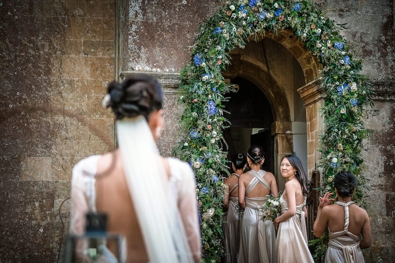 Bridemaid looks back at the bride before the ceremony Babington House wedding photography