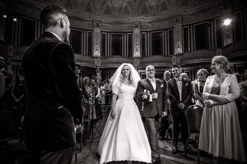 Bride walking down the aisle at St.George's Hall for a Liverpool City Centre Wedding