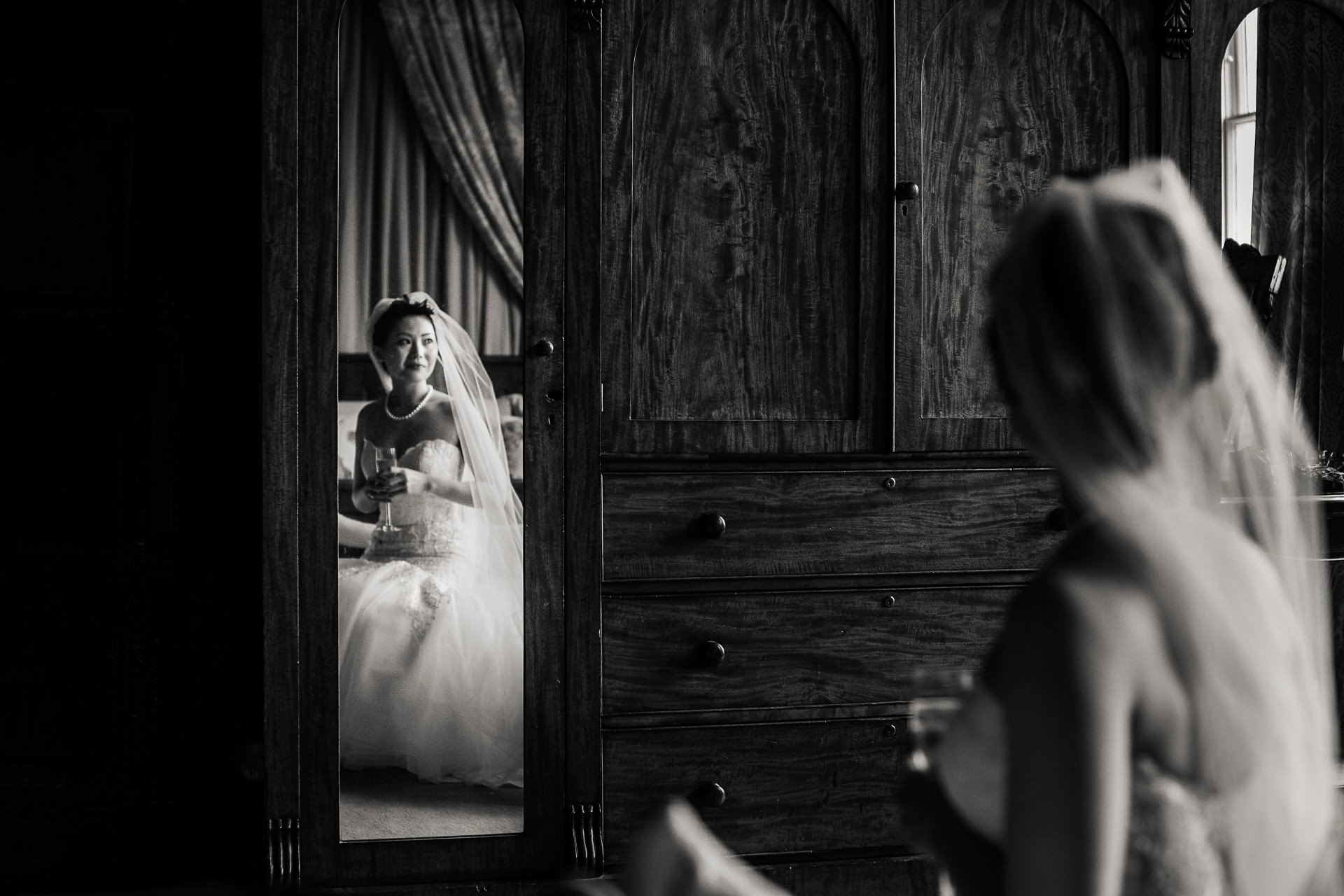 Bride reflected in mirror at Elmore Court wedding