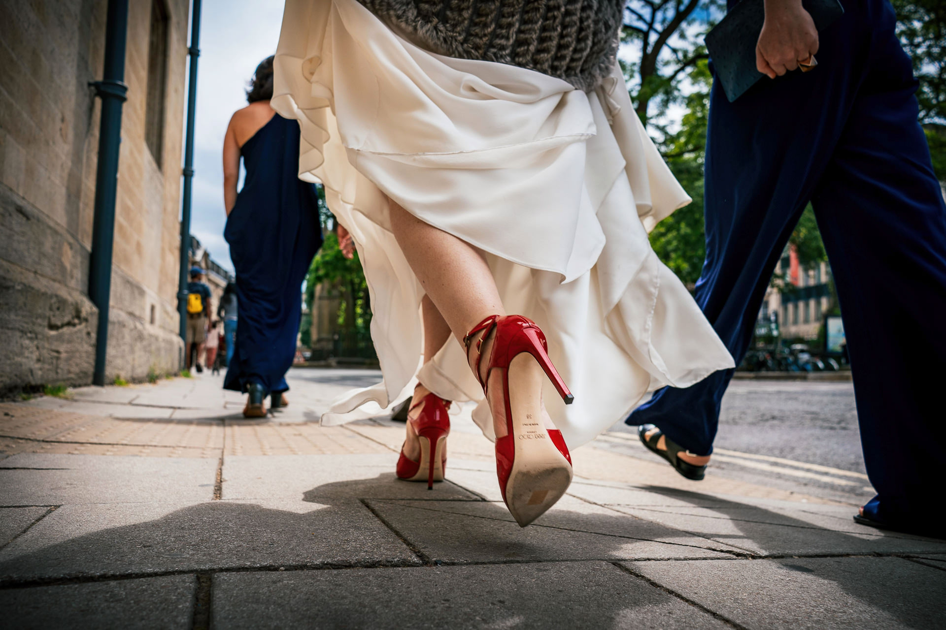 Bride walking to the church in her new Jimmy Choo wedding shoes