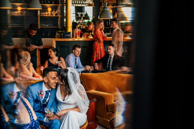 Bride and groom in the bar at FiveFourStudios Wedding in Salford
