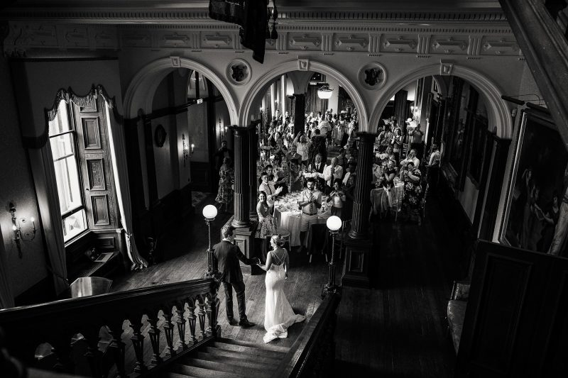 Bride and groom entering the wedding breakfast at Sandon Hall wedding in Staffordshire