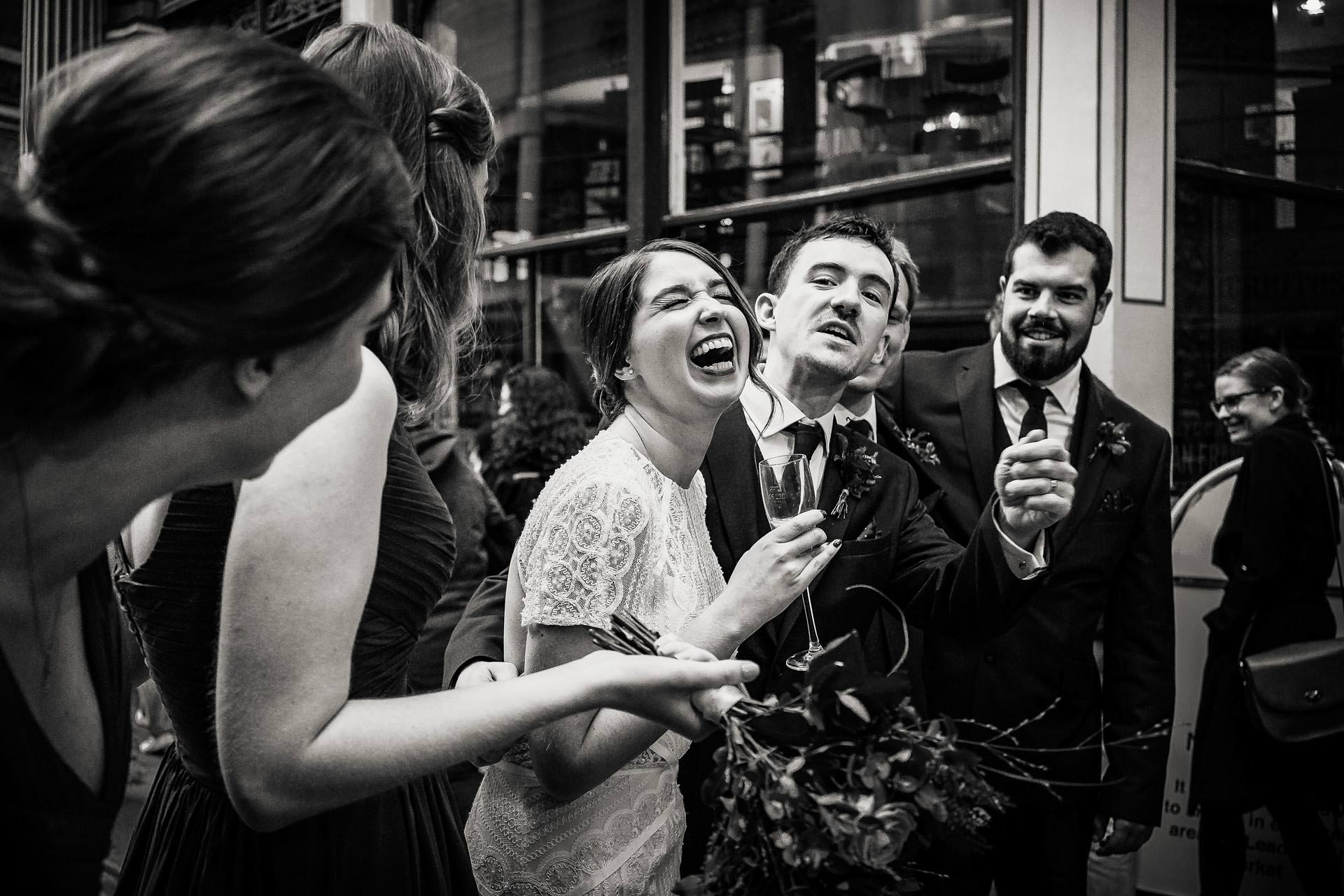 Bride laughing at a wedding at The lamb Tavern in Leadenhall in London