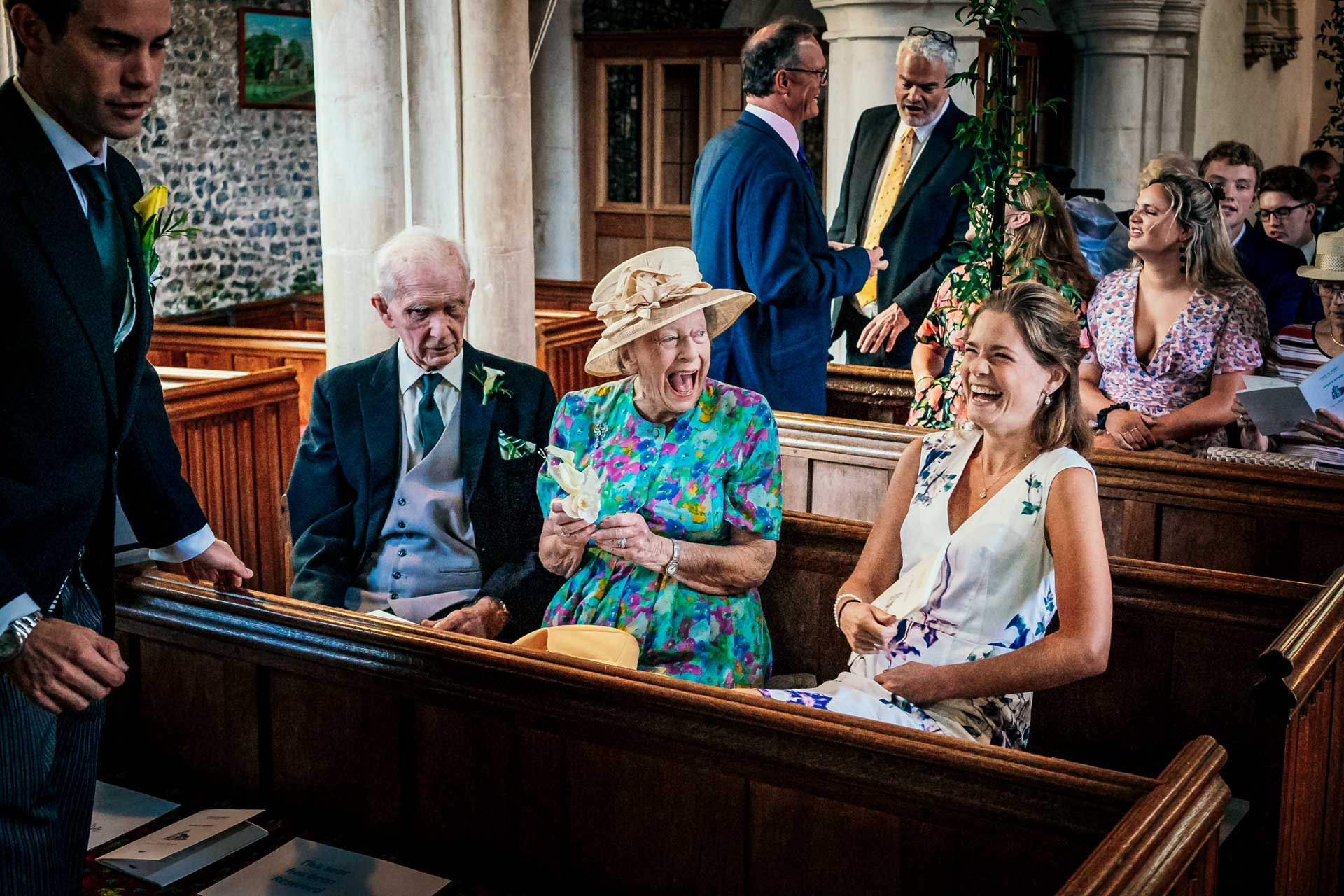 Granny laughing in the church at a Hampden House wedding