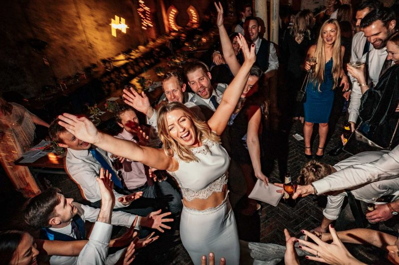 Bride on the dance floor partying at MC Motors wedding in London