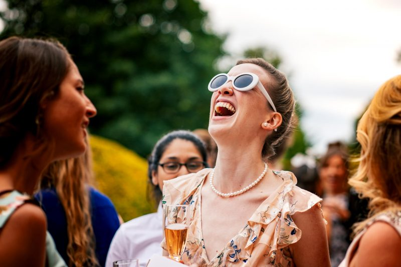 Guest laughing at Hampden House wedding