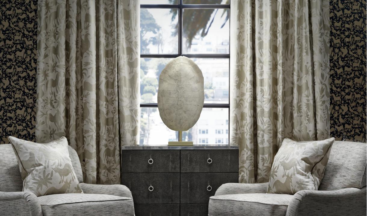 Otomi_Midnight_wallpaper_curtains_and_scatters_in_Maya_Gold_Montague_chairs_in_Delphini_Shell_with_Sybil_chest_of_drawers