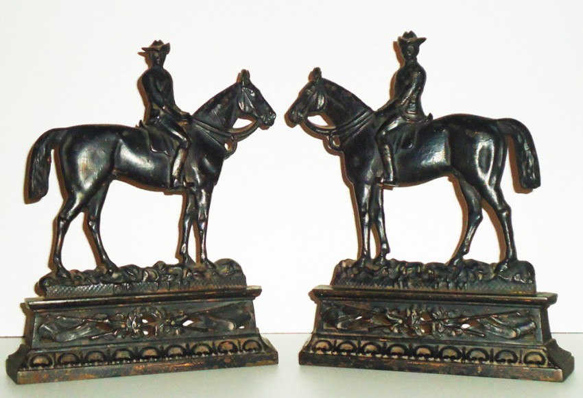 A PAIR OF PERIOD CAST IRON FIGURES OF DR. JIM ON HORSEBACK