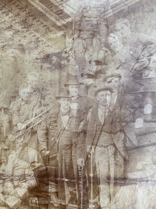 A rare 19th-century experimental multi-exposure image of men in a vaulted room.
