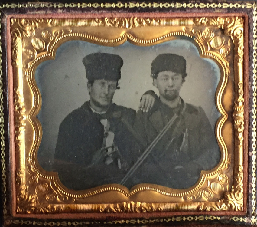 Double portrait of woman and two men with hunting guns