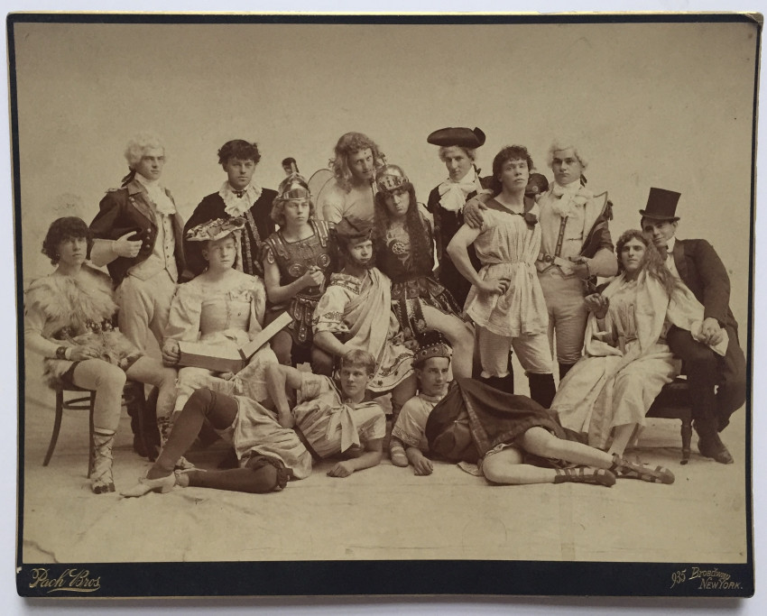 Men in theatrical costumes and in women's clothes