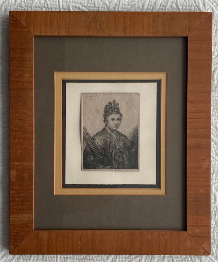 """[""""Portrait of a Native American woman ... wearing a feather headdress and holding a quiver with arrows""""]"""