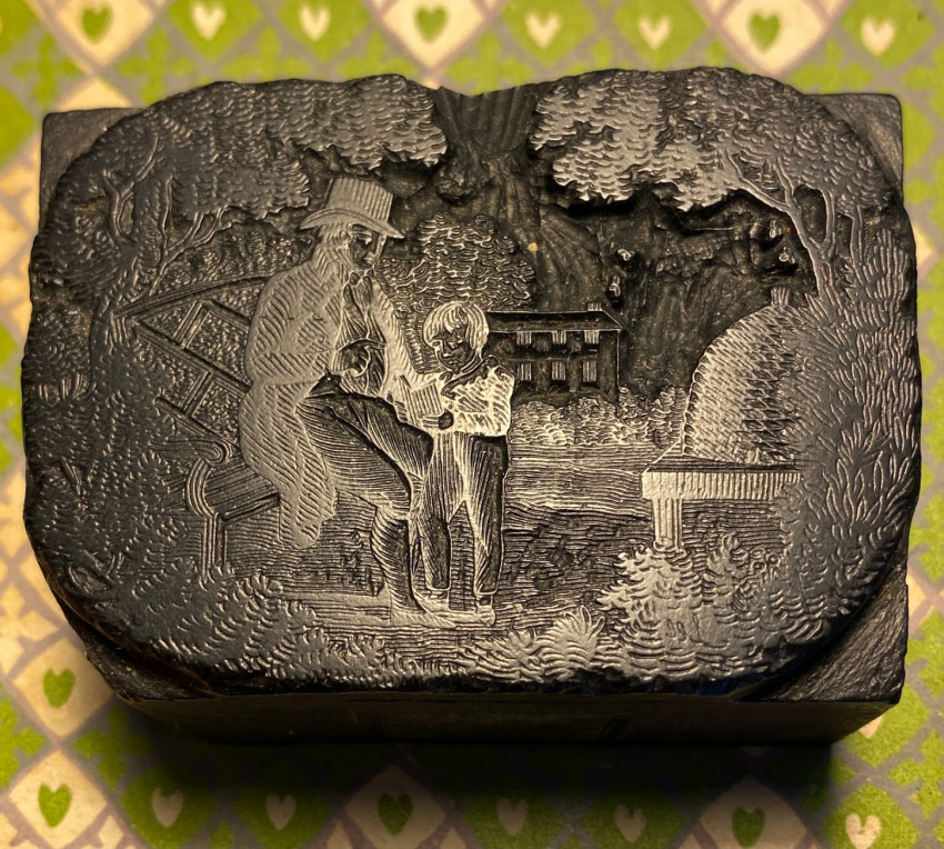Original engraved wood printing-block featuring a father, seated beside a bee skep, explaining to his son about bees.