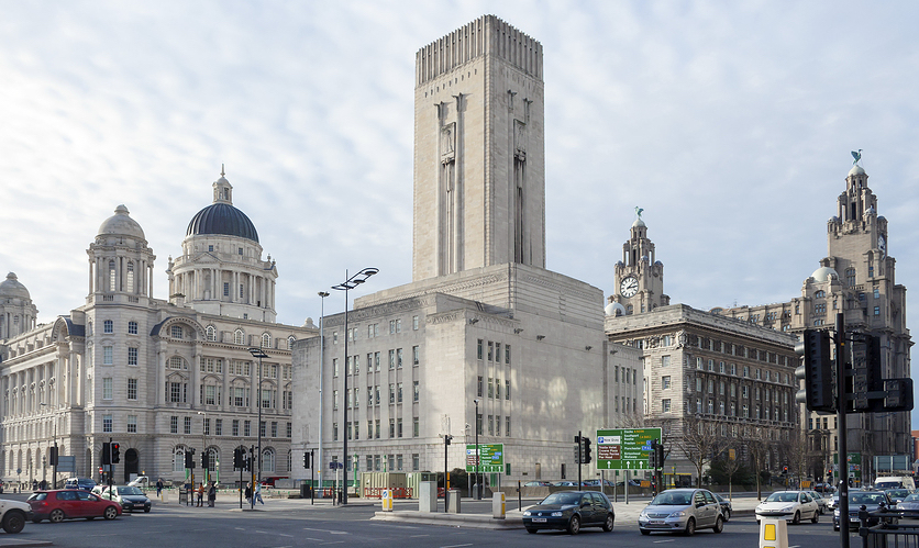 Traffic passing Liverpool's Three Graces buildings.