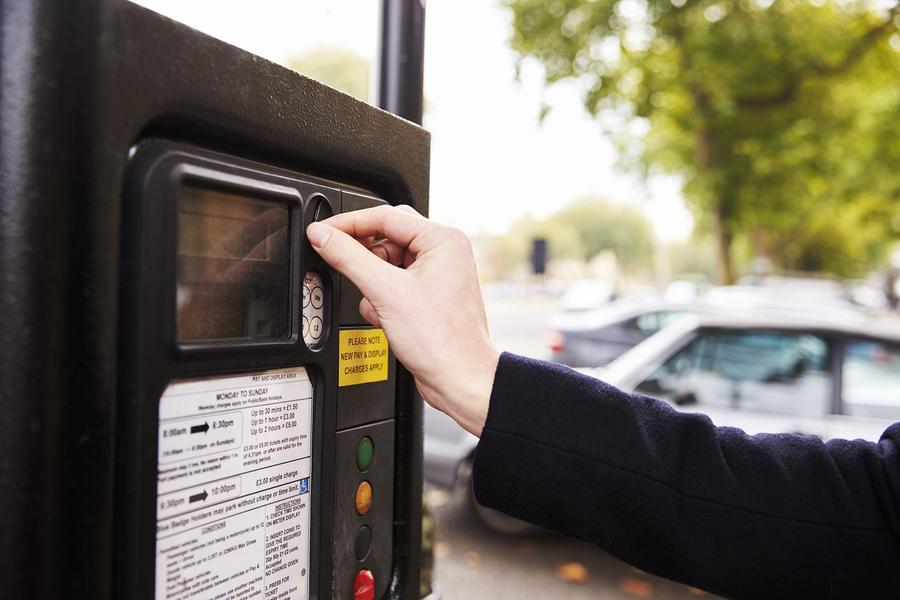 Man paying at a parking machine.