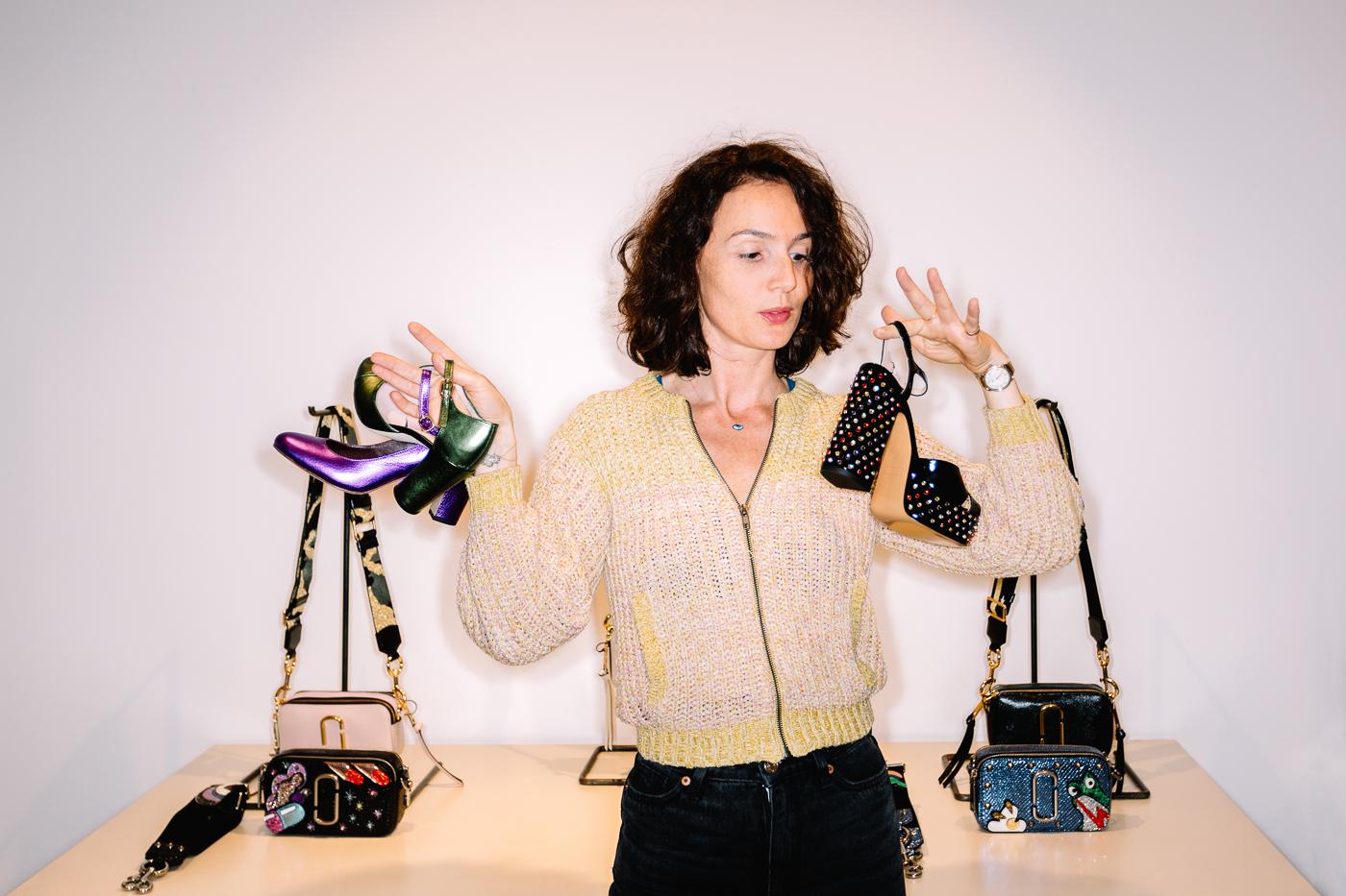 Sophie Rioufol entourée des chaussures de son magasin 58M